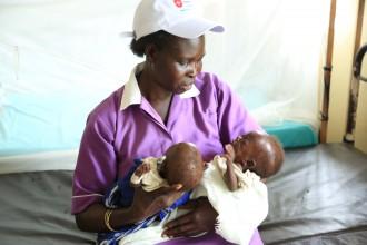 Nurse with malnourished children